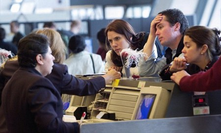 British Airways agents assist passengers at the British Airways
